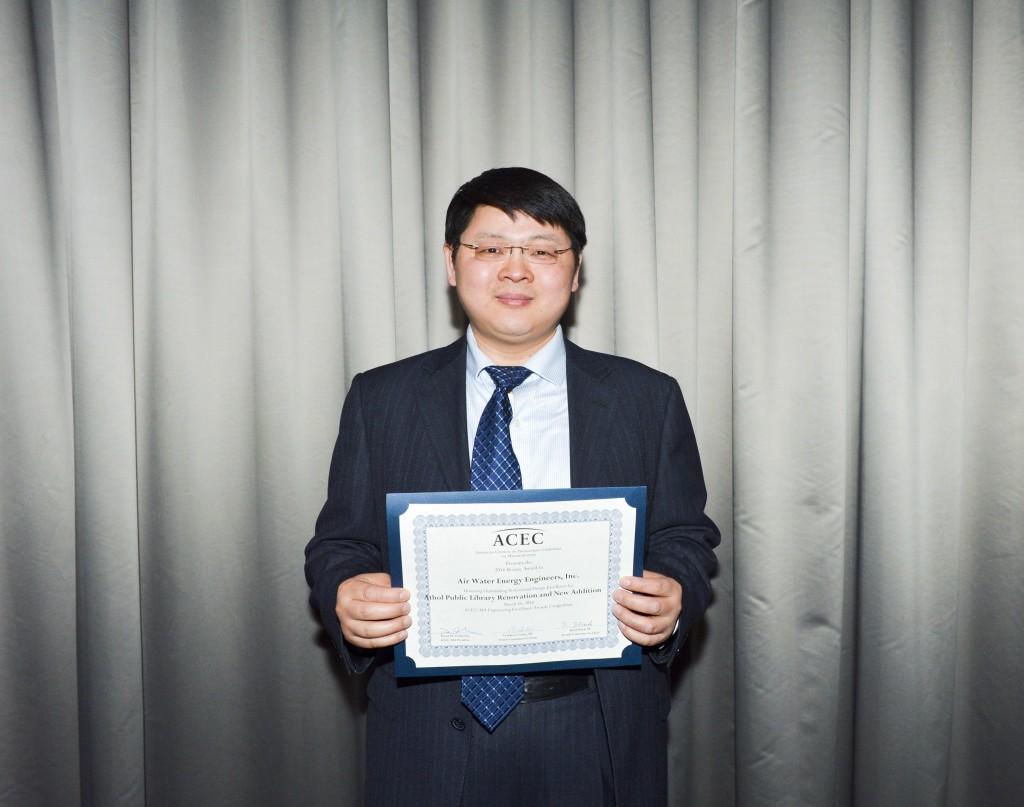 George-holding-award